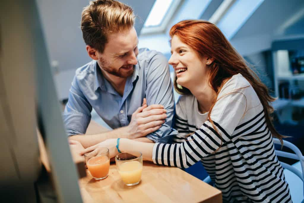 Couple in love talking smiling at home while being truly happy