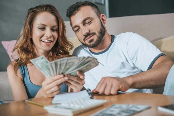 Couple planning family budget in living room