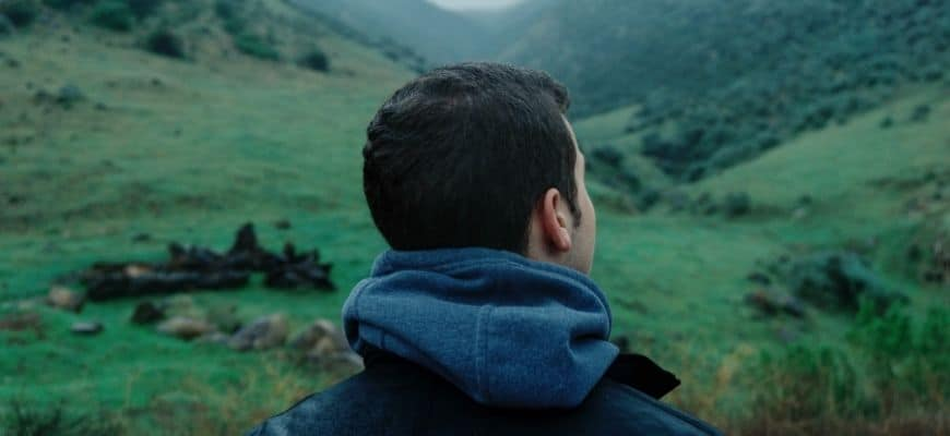 Crop image of man looking on the mountain