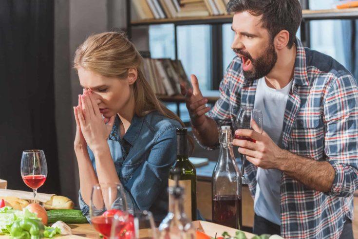 Young couple quarrel, boyfriend yelling on his sad girlfriend