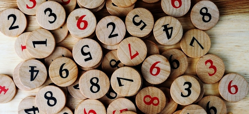wooden circle coin with different numbers printed on them