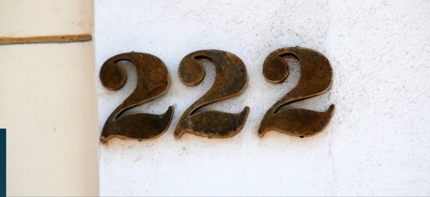 Number 222 on a white wall