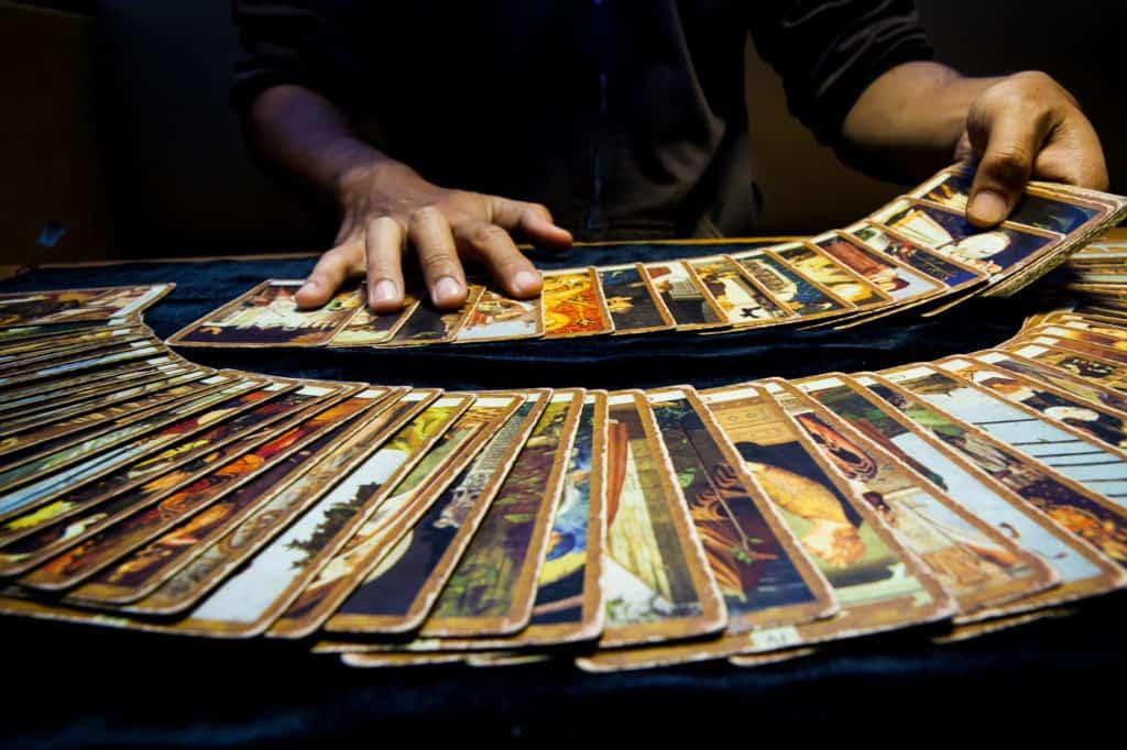 Man hand palying tarrot cards