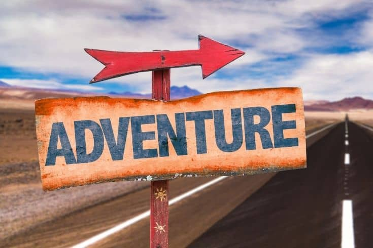Adventure sign on the road
