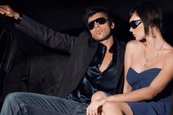 Celebrity Couple Wearing Sunglasses In Limousine