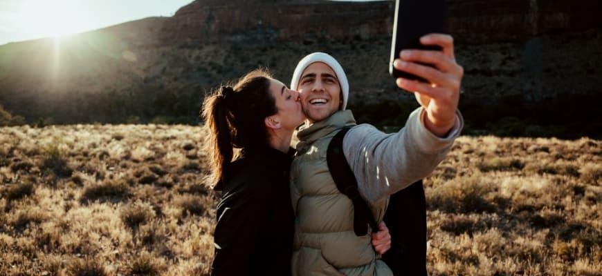 Young adventurous couple taking selfie